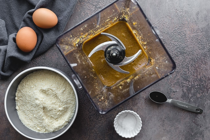 Overhead view of wet ingredients blended together in a blender.