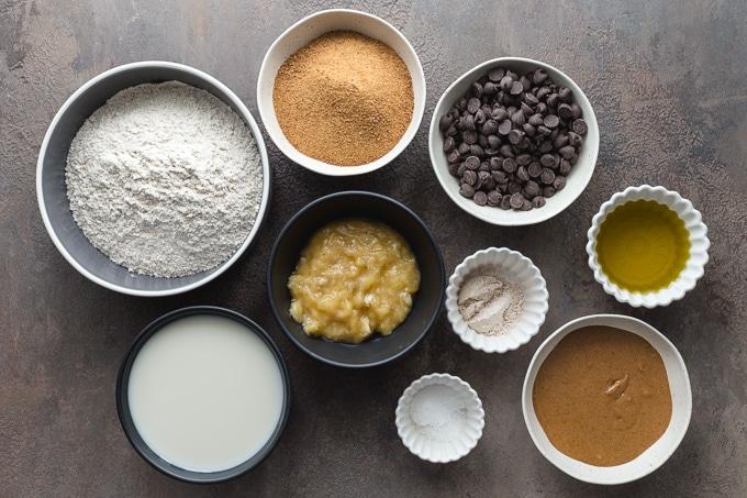 Ingredients for vegan banana cake arranged in individual bowls.
