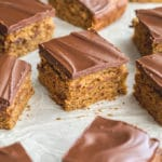 Banana snack cake topped with chocolate and cut into squares.