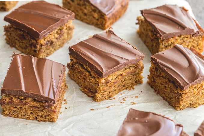 Pieces of whole wheat banana cake topped with chocolate.