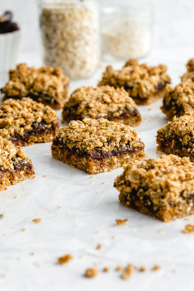Side view of healthy date squares arranged on a white surface.
