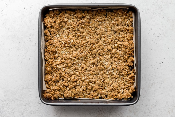 Vegan date squares baked up in a square pan.