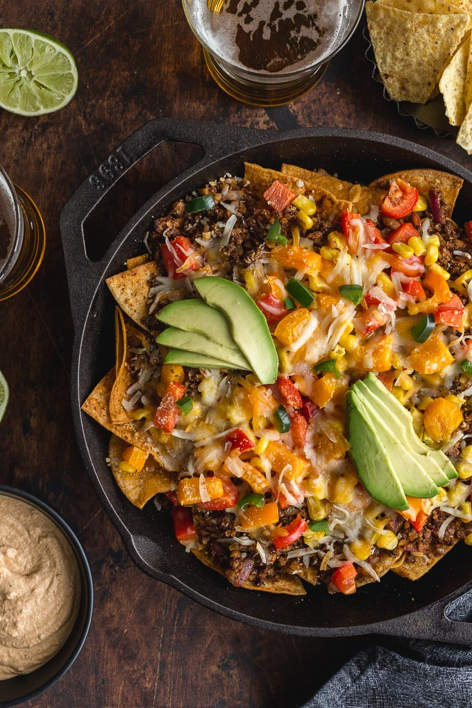Up-close view of vegetarian nachos in a cast iron pan.