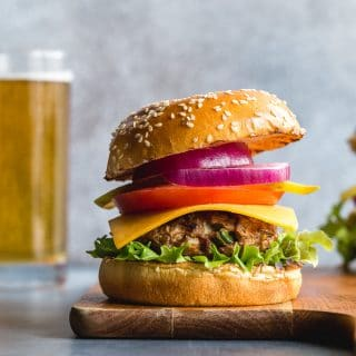 Side view of a turkey jalapeno burger on a wooden board.