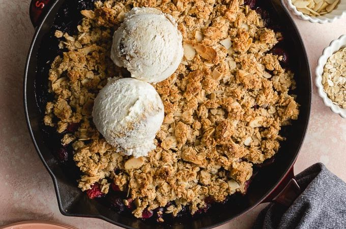 Cherry Almond Crisp baked up in a cast iron skillet.