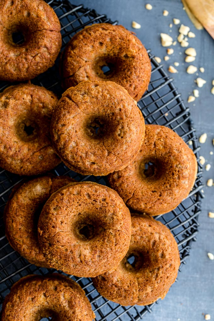 Protein donuts without glaze on a cooling rack.
