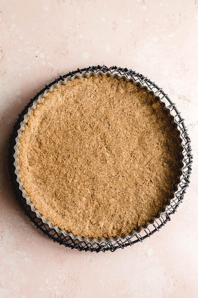 Almond butter crust cooling on a wire rack.