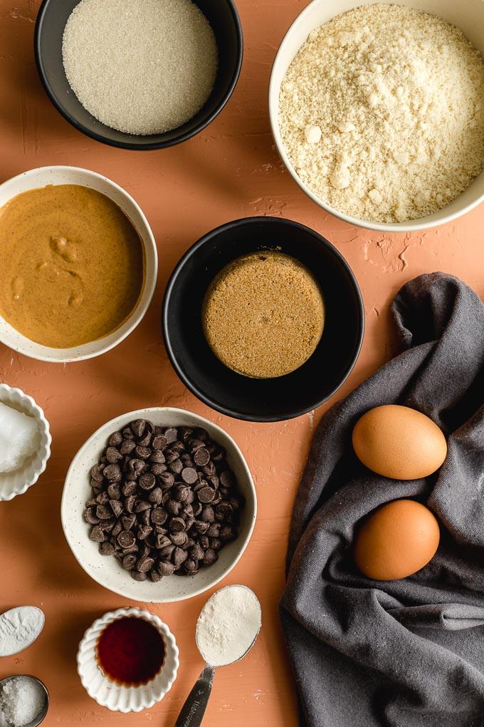 Overhead view of ingredients to make blondies arranged in individual bowls.