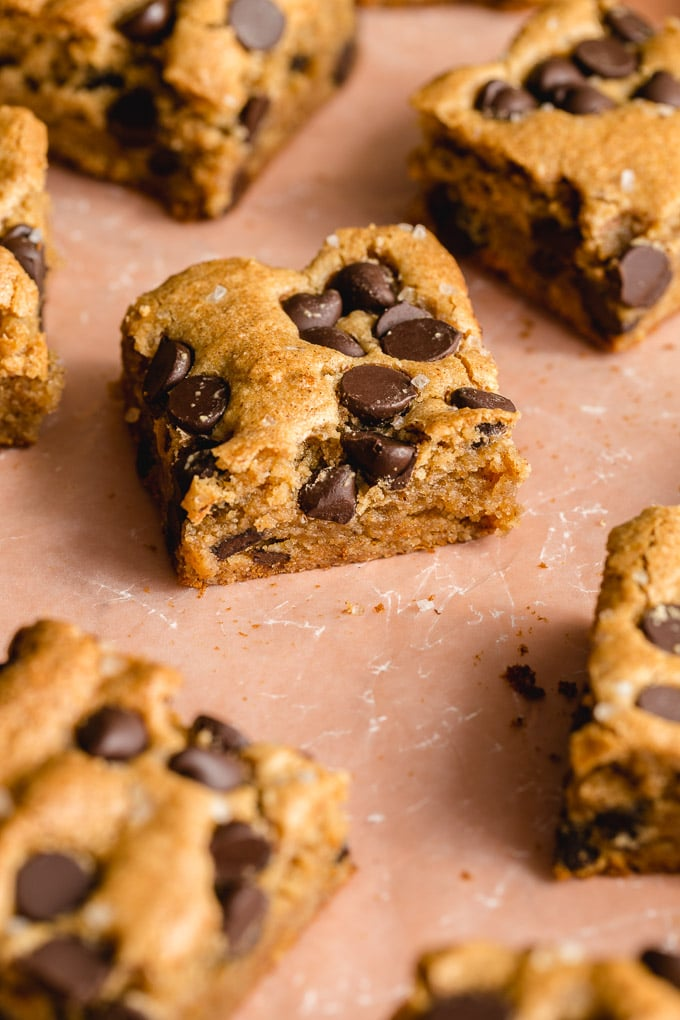 Up-close side view of a dairy-free blondie with chocolate chips.