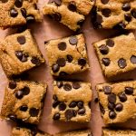 Almond flour blondies loaded with chocolate chips and cut into bars.