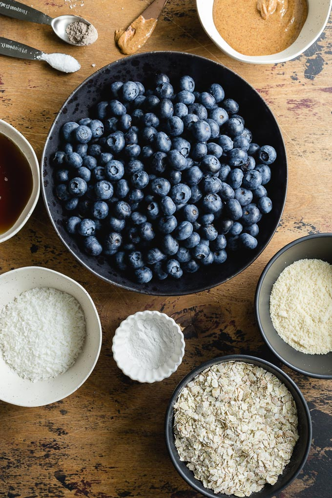 Overhead view of ingredients to make a blueberry crisp without oats.