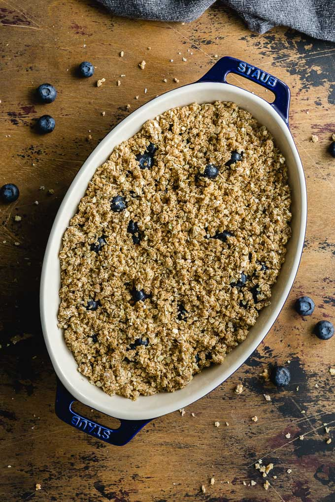 Pre-baked gluten-free blueberry crisp ready for the oven.