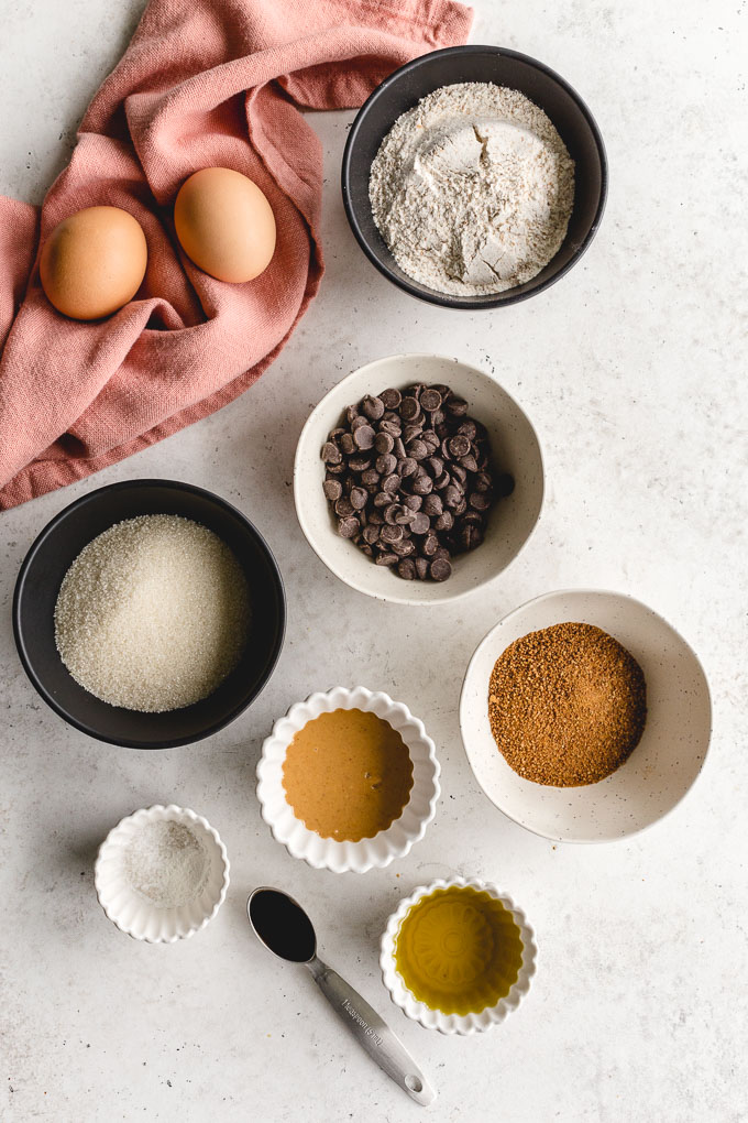 Ingredients to make homemade ice cream sandwiches arranged in individual bowls.