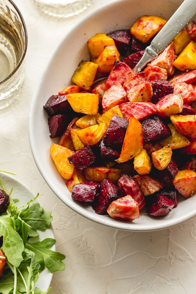 Up close view of air fryer beets in a white bowl.