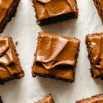 Healthy chocolate zucchini cake topped with avocado frosting and cut into squares.