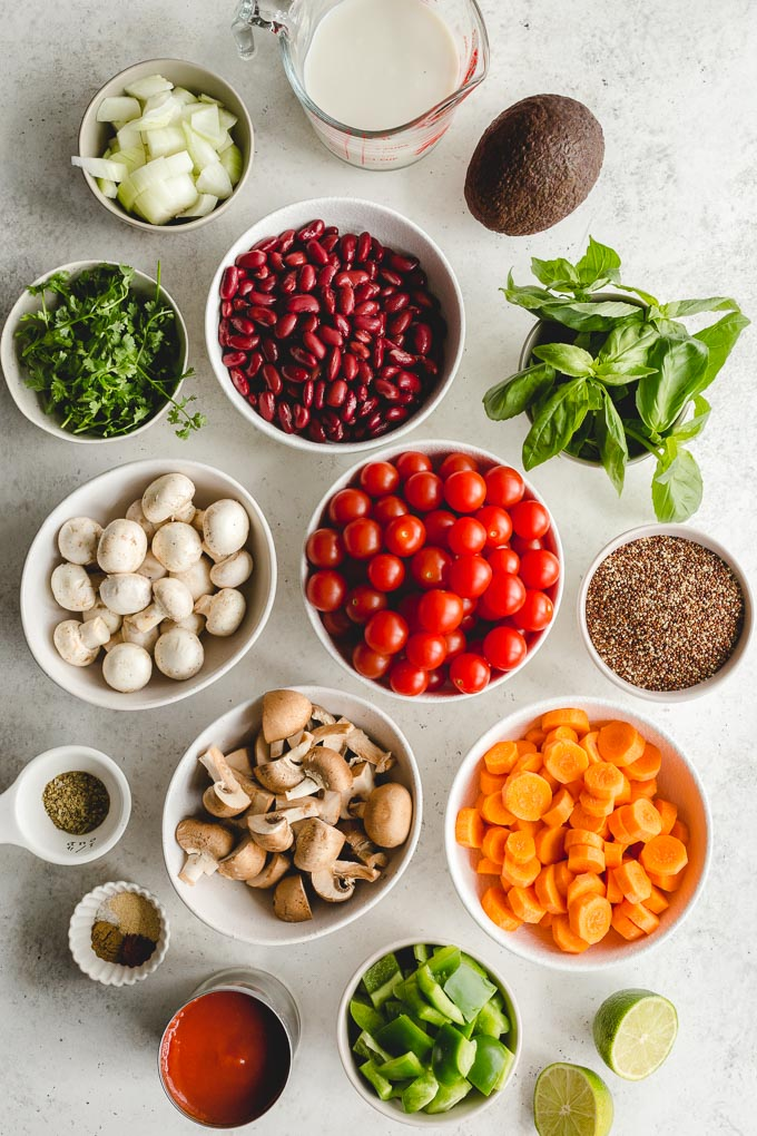 Overhead view of the ingredients to make crockpot vegetarian chili arranged in individual bowls.