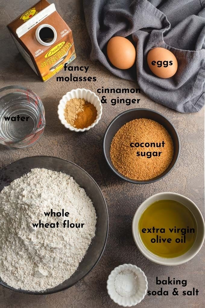 Overhead view of individually arranged ingredients for the easy gingerbread cake recipe.
