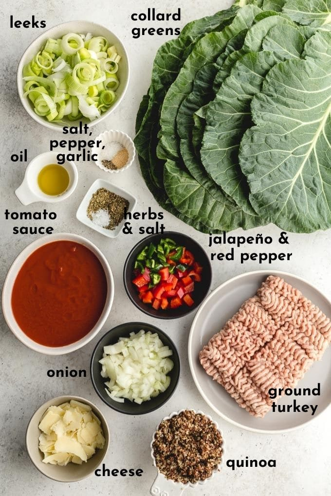 Ingredients to make stuffed collard greens labelled and arranged individually on a light coloured surface.