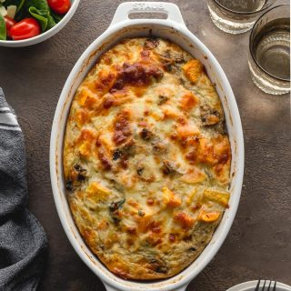 Sweet Potato Breakfast Casserole with ground turkey and eggs in a white, oval dish.