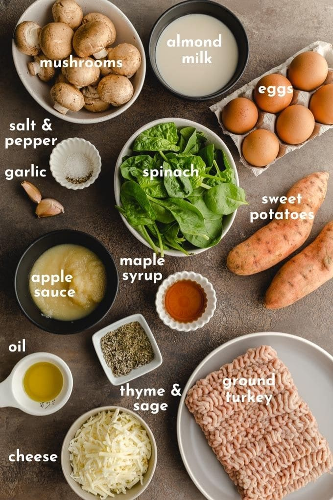 Overhead view of all the casserole ingredients arranged individually on a dark surface.