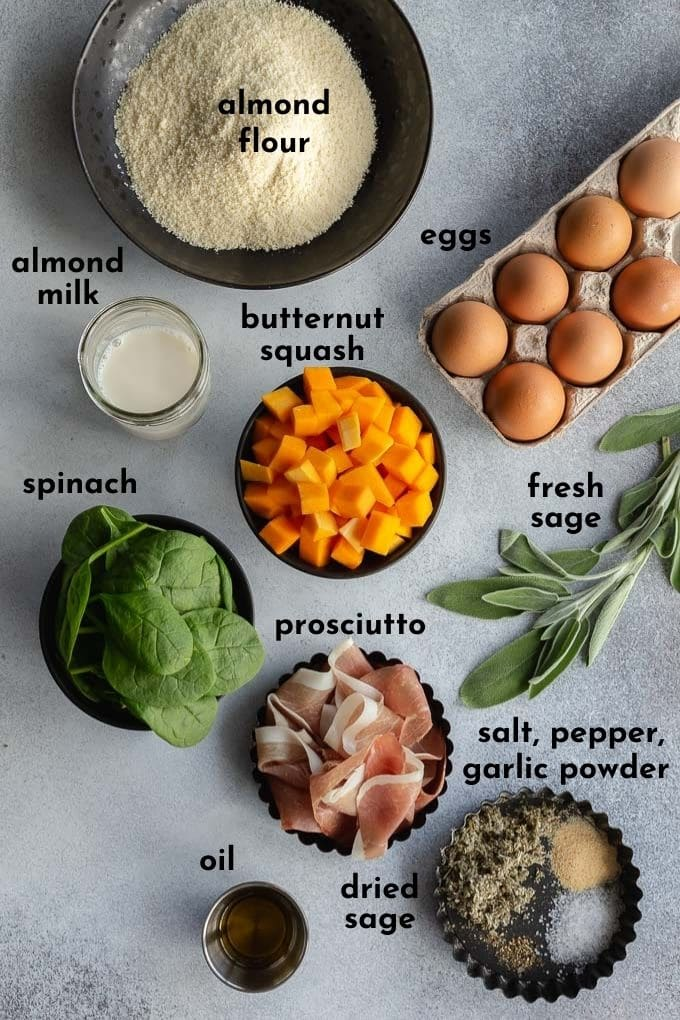 Ingredients to make squash quiche arranged individually and labelled.