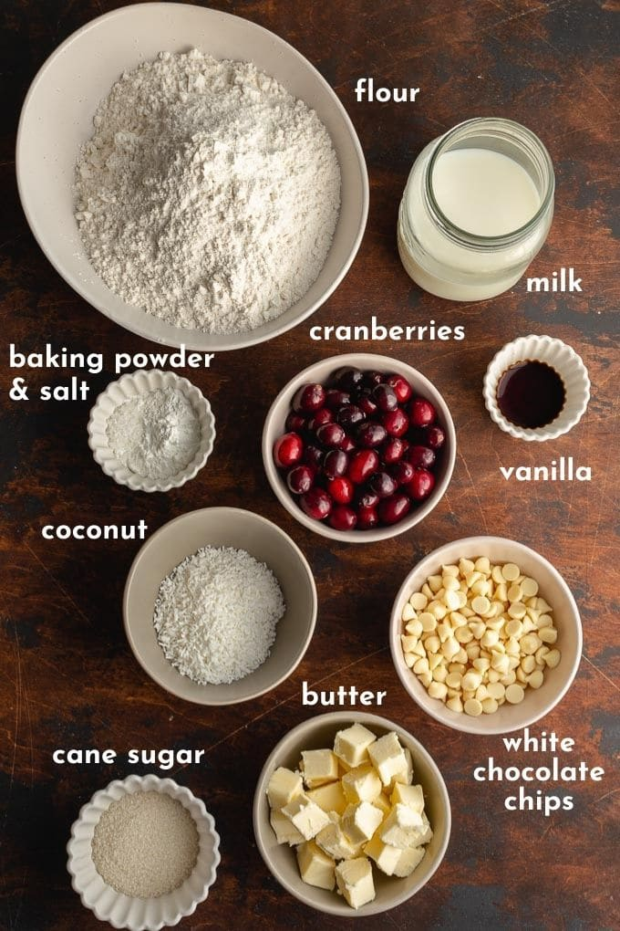 Ingredients to make cranberry breakfast buns arranged individually and labelled.