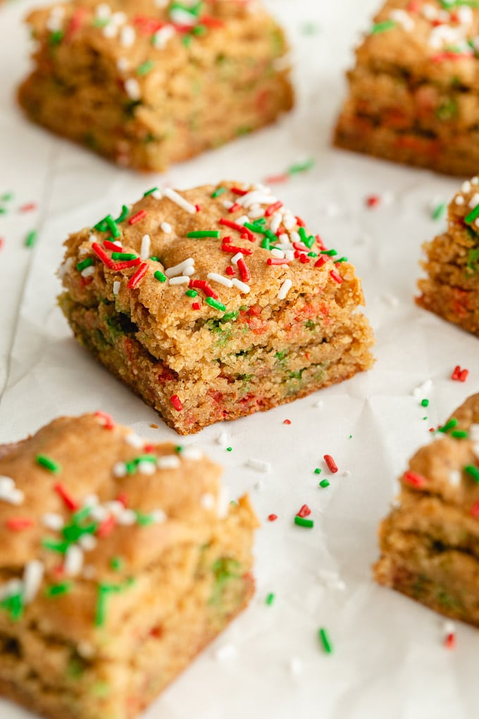 Up close view of Christmas blondies with sprinkles.