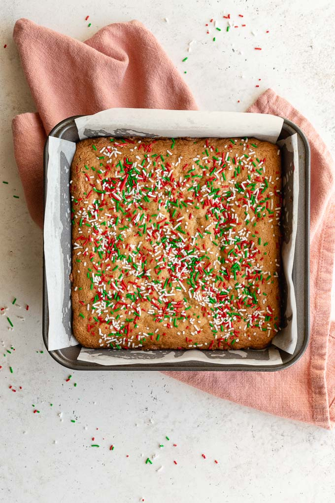 Christmas funfetti blondies baked up in a square pan.