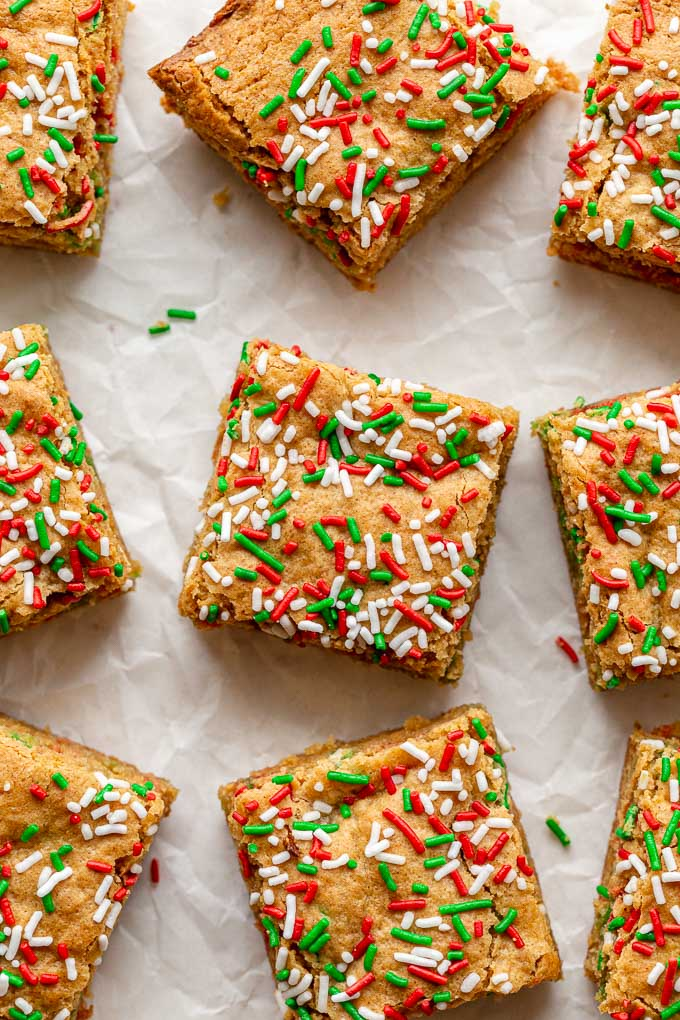 Overhead view of peanut butter blondies with Christmas sprinkles on top.