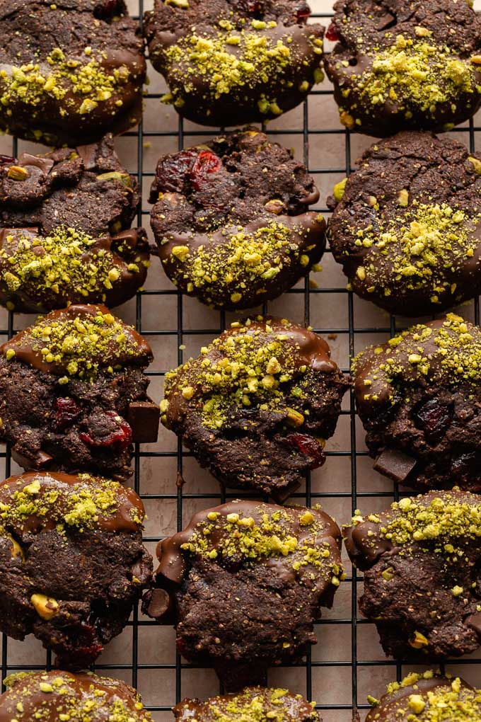 Chocolate pistachio cookies cooling on a wire rack.