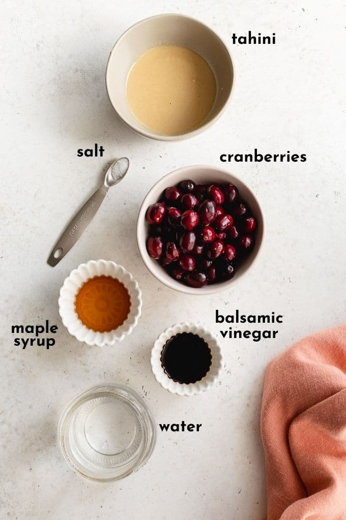 Overhead view of ingredients to make the salad dressing arranged individually and labelled.