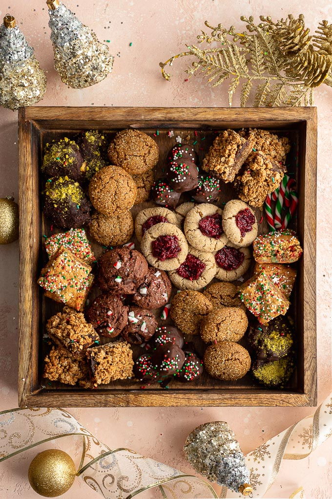 An assortment of dairy-free Christmas cookies in a wooden box.