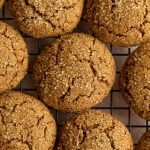 Ginger molasses cookies arranged on a cooling rack.