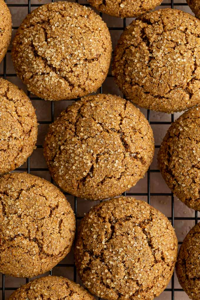Overhead view of molasses ginger cookies clustered together on a cooling rack.