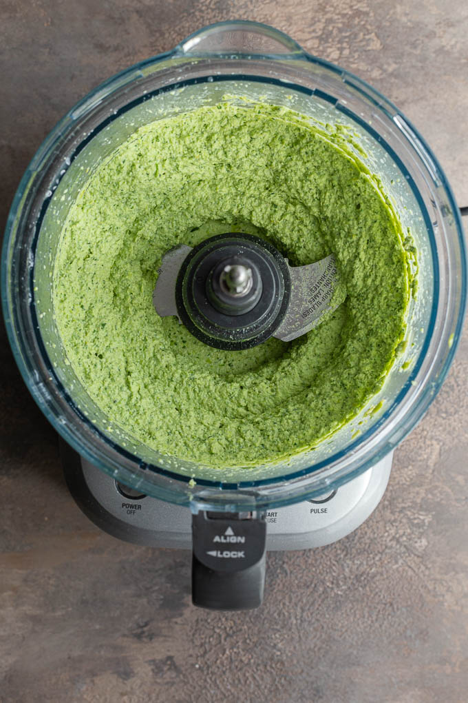 Overhead view of edamame hummus mixed together in a food processor bowl.