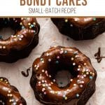 Pinterest image of a mini chocolate bundt cake topped with glaze and sprinkles.