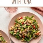 Pinterest image for white bean tuna salad served on a pink plate.