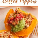 Pinterest image of an air fryer stuffed pepper cut in half on a white plate.