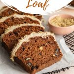 Pinterest image of carrot cake loaf cut into slices and arranged on a sheet of parchment paper.