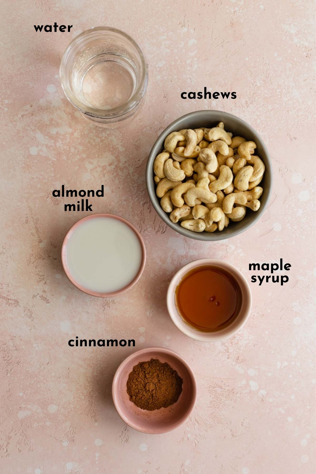 Ingredients for cashew cream frosting arranged individually and labelled.