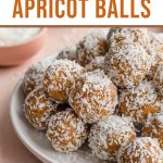 Pinterest image with a close up side view of coconut apricot balls on a white plate.