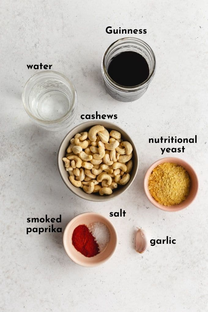 Ingredients to make Guinness cashew cheese sauce arranged individually and labelled.