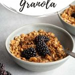 Pinterest image with a side view of maple granola in a grey bowl.