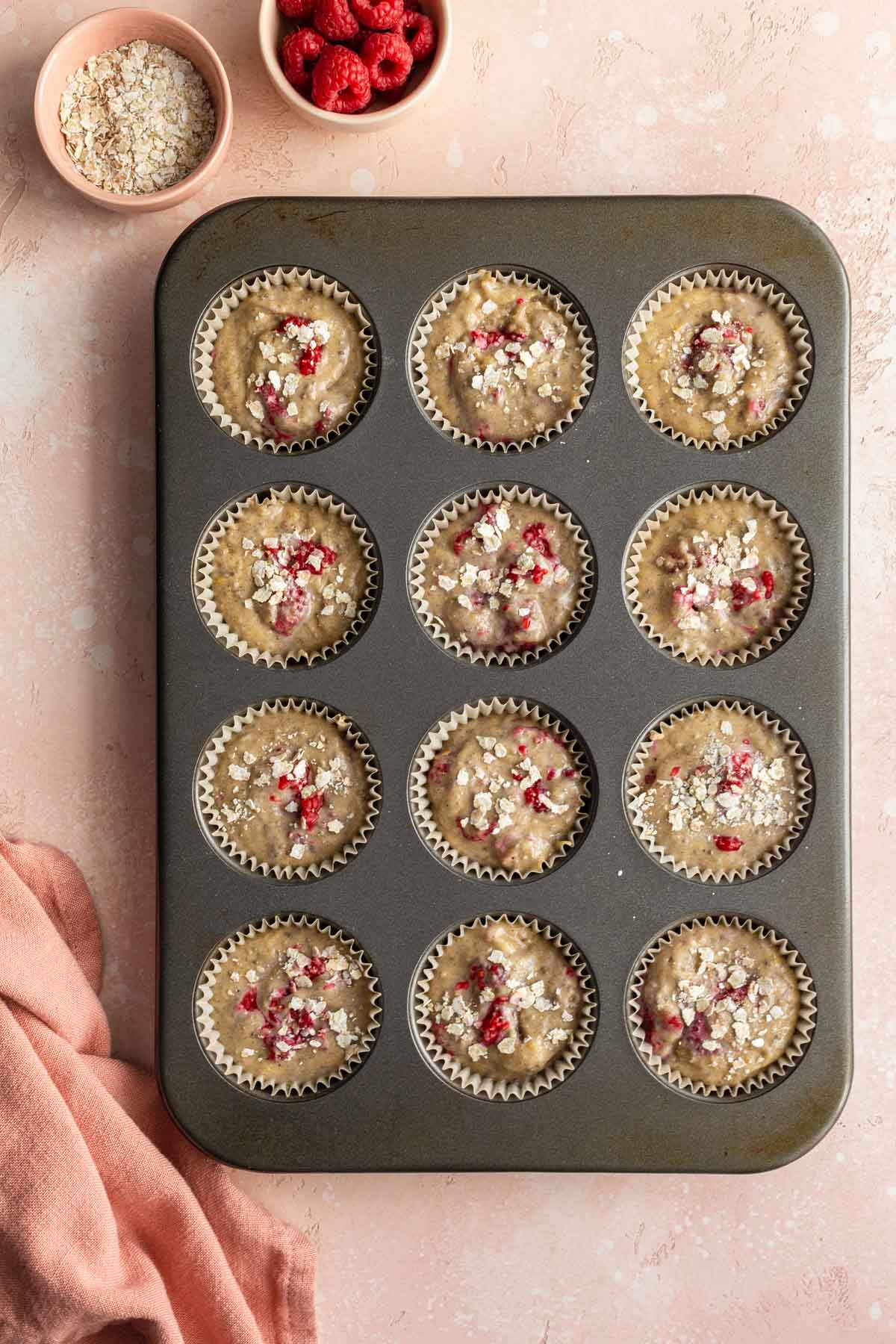 Muffin batter divided into a 12-cup muffin pan.