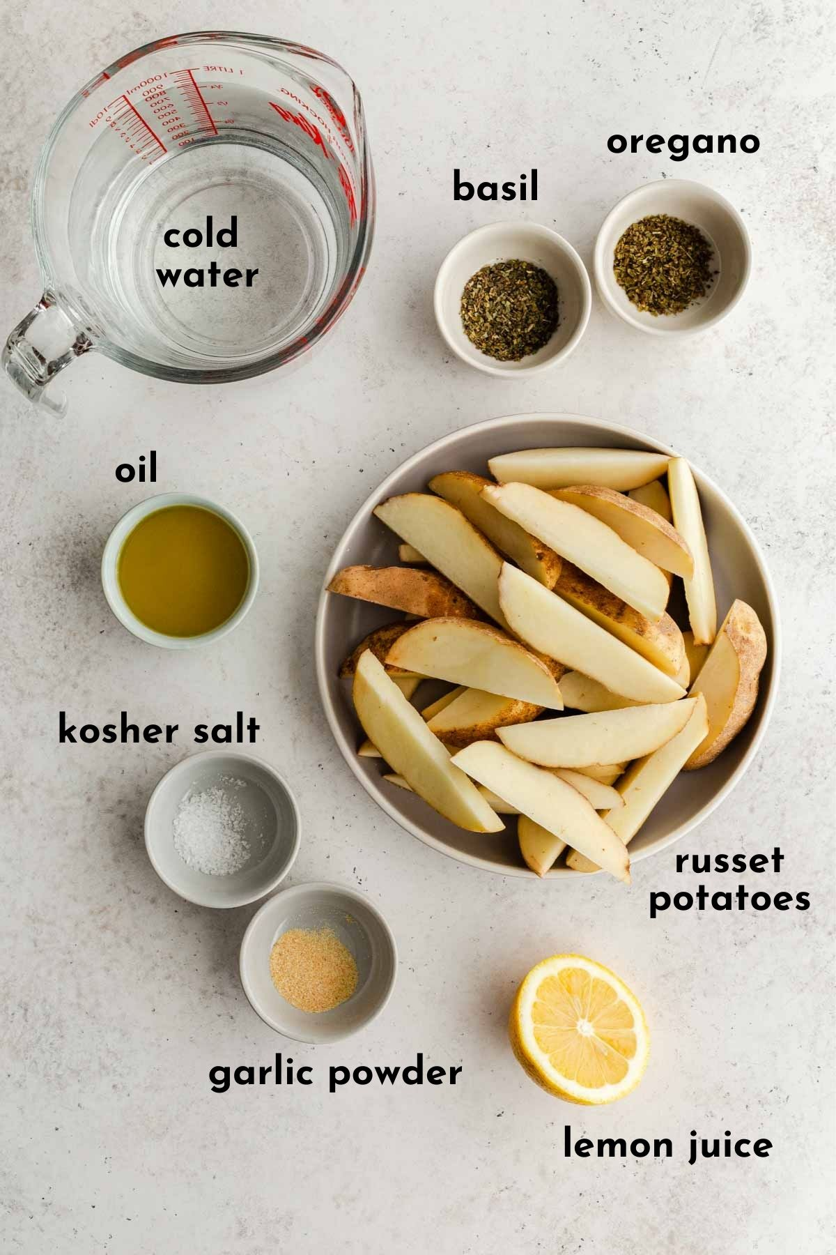 Ingredients to make wedge fries arranged individually and labelled.