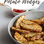 Pinterest image of wedge fries in a grey bowl.