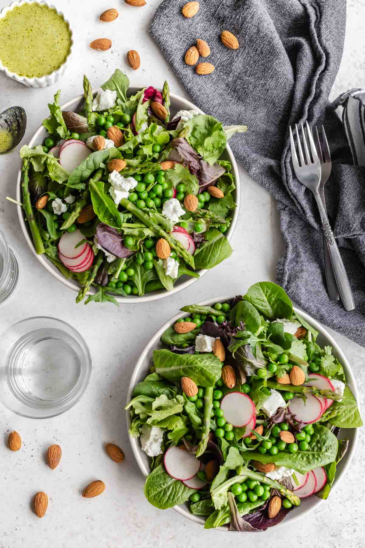Overhead view of two plates of spring salad.