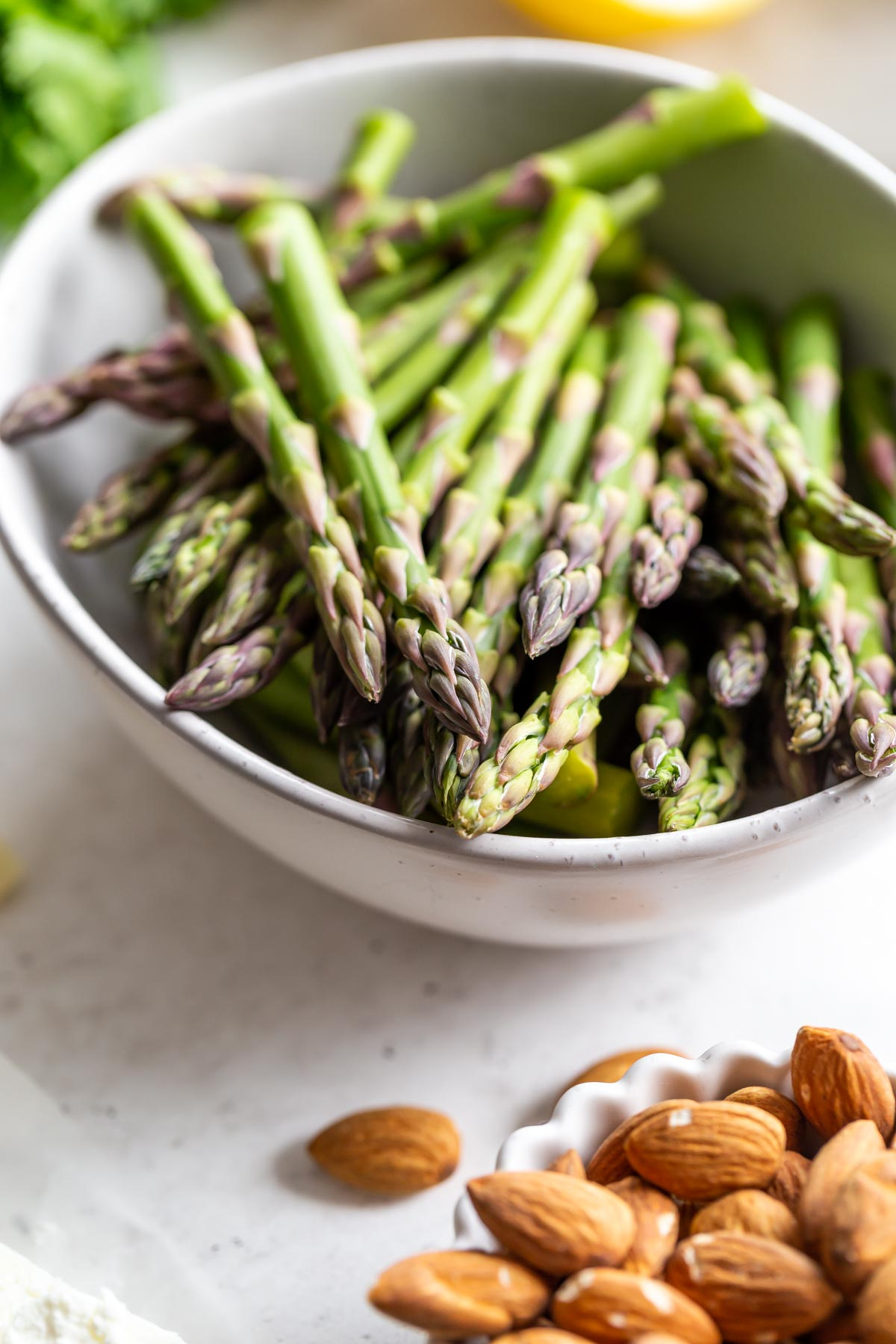 Up close of asparagus spears in a bowl.
