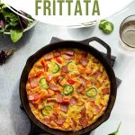 Pinterest image of a frittata with sweet potato and turkey bacon in a cast iron skillet.