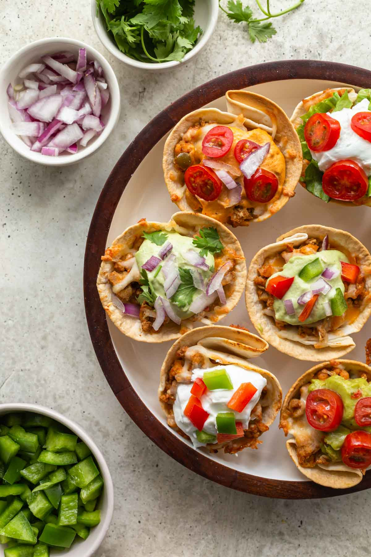 Up close and overhead view of taco cups on a white plate.